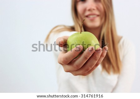 An apple a day or a Beautiful girl with apple, Healthy eating, Good idea, Take away - stock photo