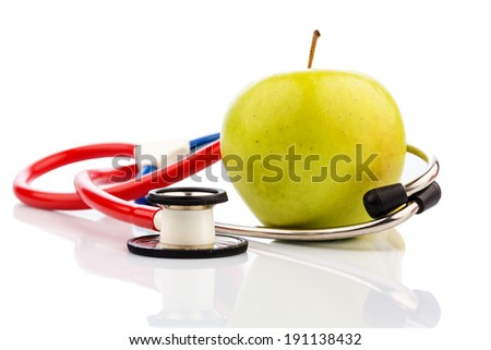 an apple and a stethoscope on a doctor. symbolic photo for healthy and vitamin-rich diet. - stock photo