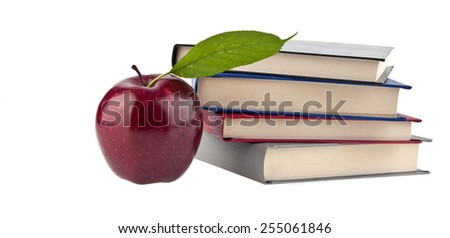 an apple and books is isolated on a white background - stock photo