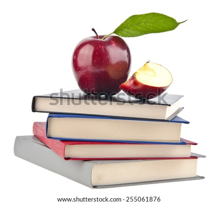 an apple and books is isolated on a white background