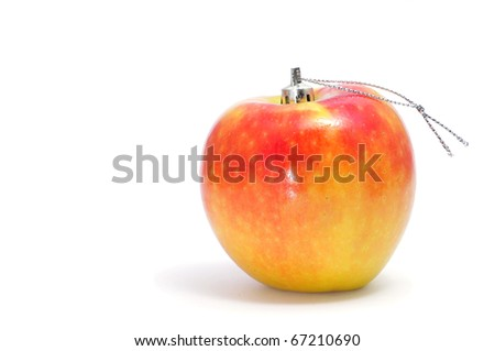 an apple as a christmas ball on a white background