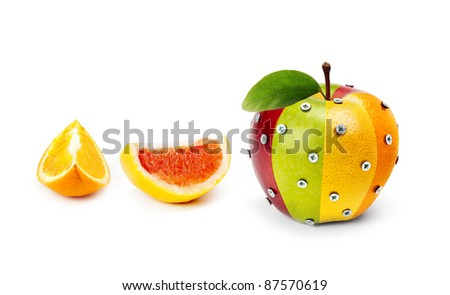 An Apple composed by several fruits attached by bolts and some fruit slices - stock photo