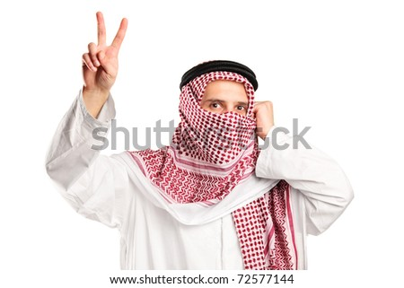 An arab man with covered face gesturing victory isolated on white background - stock photo