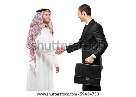 An Arab person shaking hands with a businessman isolated on white background - stock photo
