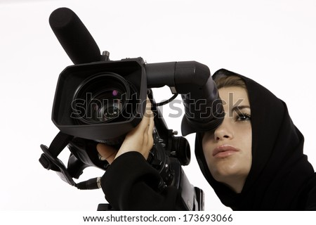 An Arab Student Looking Through A View Finder In A Filming Studio - stock photo