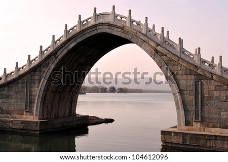 An Arch Bridge at The Summer Palace in Beijing, China. - stock photo