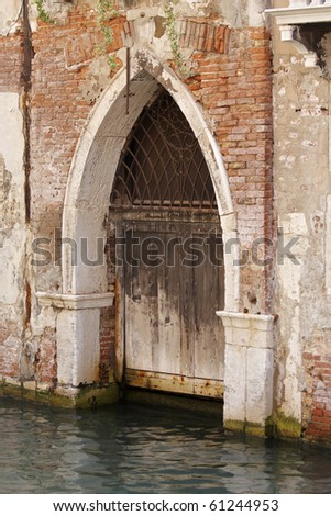An arched gothic doorway fronting on a canal in Venice