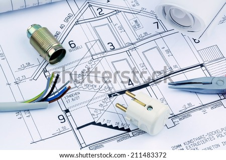 an architect's blueprint for the construction of a new residential house. symbolic photo for funding and planning of a new house. - stock photo