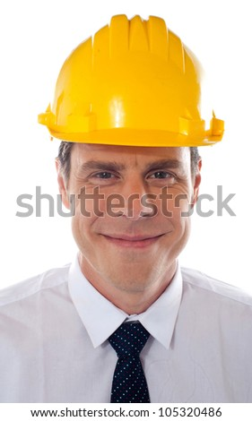 An architect wearing yellow safety helmet looking confidently at camera - stock photo