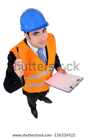 An architect with a clipboard. - stock photo