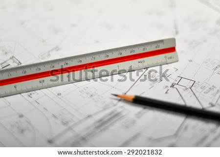 An architects workspace with tools : pencil ,ruler ,scale and blueprint - stock photo