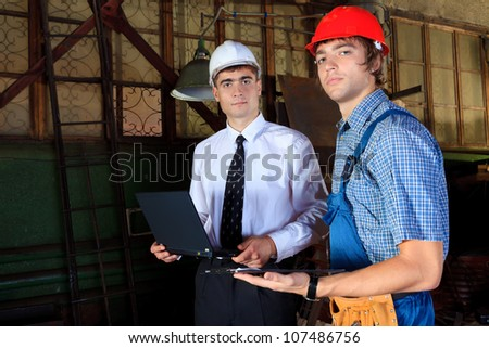 An architecture and worker at a manufacturing area.