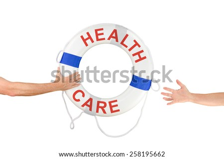 An arm is reaching out with a HEALTH CARE life buoy to help the people that need health care and who are reaching out for help. - stock photo