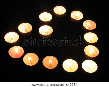 An arrangement of tea-light candles in the shape of a heart - stock photo