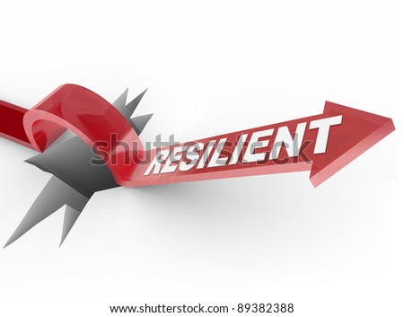 An arrow jumps over a hole, with the word Resilient to illustrate a winning attitude and determined approach to conquering a problem - stock photo