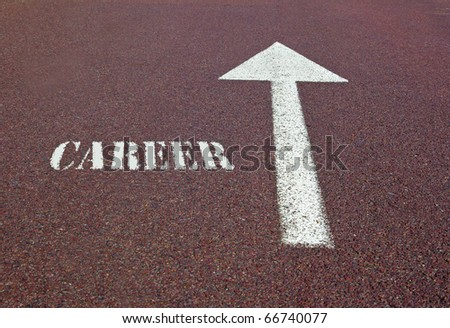 an arrow on the asphalt showing the direction for making a career