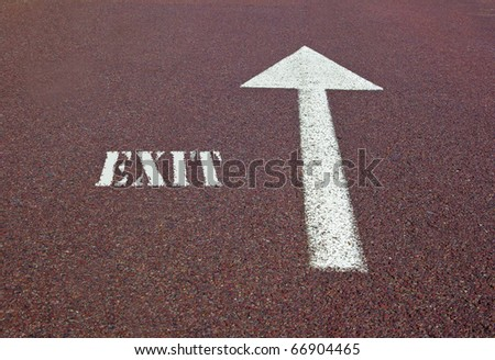 an arrow on the asphalt showing the exit direction - stock photo