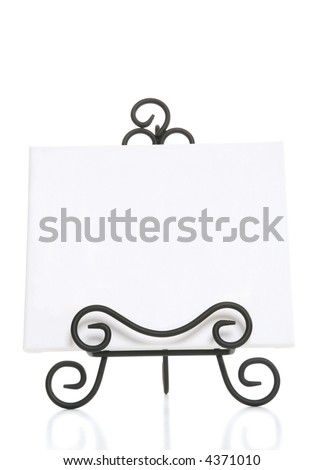 An art easel for a painter over a white background - stock photo