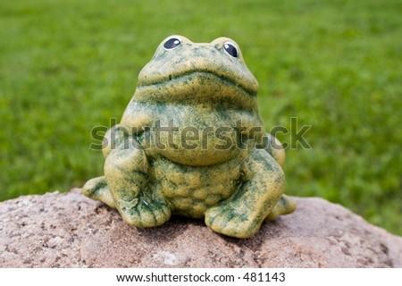 An artificial frog in the garden - stock photo