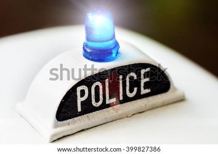 an artificial toy of police siren closeup - stock photo