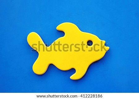 An artificial yellow fish.  - stock photo