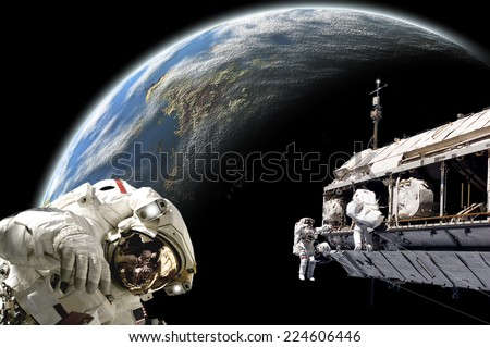 An artist's depiction of  a team of astronauts performing work on a space station while orbiting a large, Earth-like planet. Elements of this image furnished by NASA. - stock photo