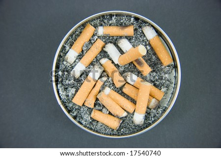 An ashtray with cigarettes and ash.
