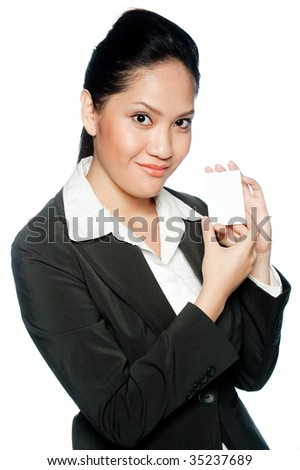 An asian businesswoman holding a blank business card