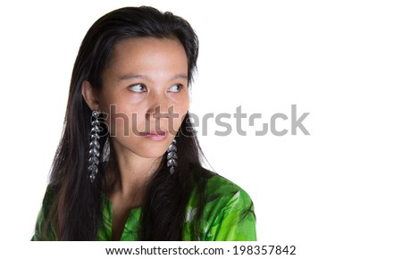 An Asian Malay lady with the Malaysian National dress the baju kurung over white background