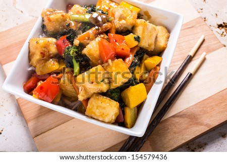 An Asian stir fry with tofu, vegetables and rice.