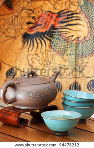 An Asian tea set on a colorful background. - stock photo
