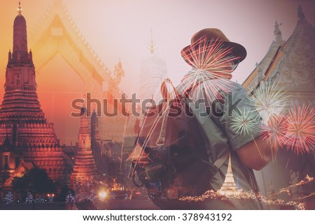 An Asian traveling man concentrate and appreciate in ancien art of the old historic architecture in Thailand. Image make vintage tone. - stock photo