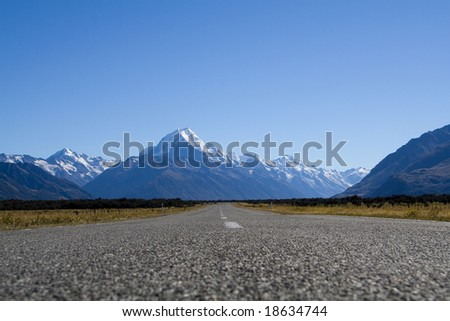 An asphalt road on the way to mighty mt. cook in New Zealand