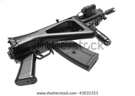 An assault rifle with a folding stock.