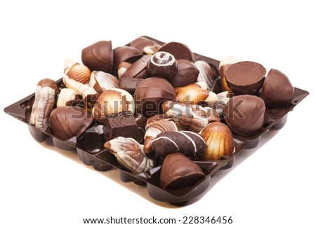 An assortment chocolates isolated on white  - stock photo