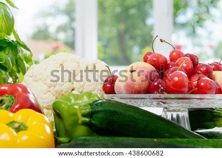 an assortment of fresh vegetables and fruits