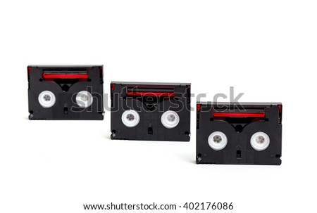 An assortment of mini dv cassette tapes, isolated on white - stock photo