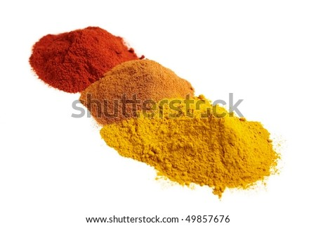 An assortment of red, brown and yellow spices