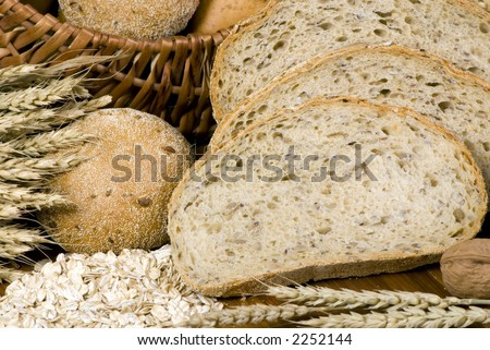 An assortment of whole grain wheat breads on a table.