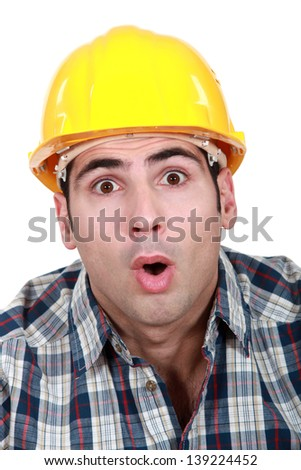 An astonished tradesman - stock photo