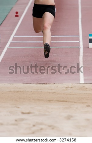 An athlete competing in the long jump