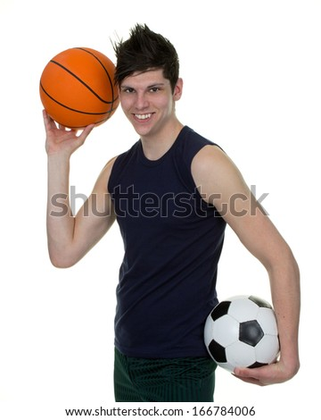 An athlete holding a basketball and a football, isolated on white