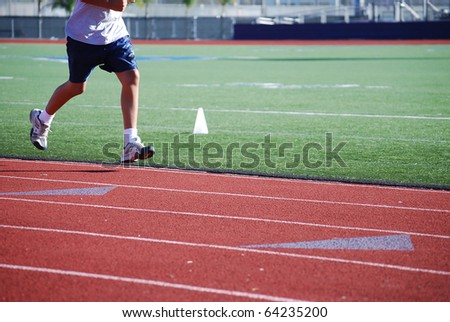 An athlete trains in the sports arena. - stock photo