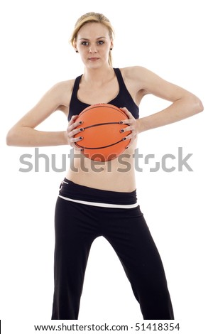 An athletic girl holding a basketball  isolated over white background