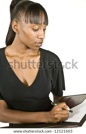 An attractive African American office worker, business  woman or student taking notes. - stock photo