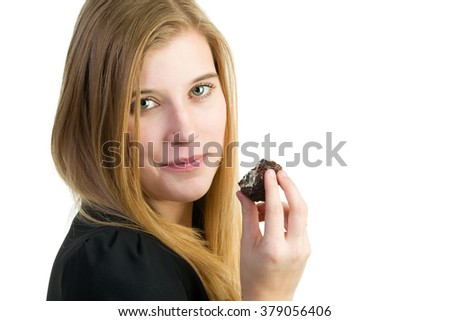 An attractive blond woman eating chocolate cake - stock photo