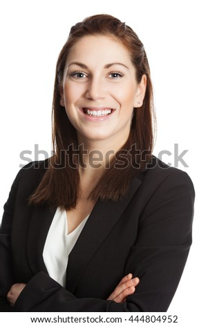 An attractive brunette businesswoman wearing a black suit and white shirt, standing with her arms crossed against white background. - stock photo