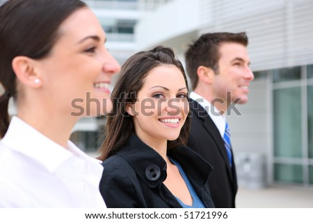 An attractive business man and woman team at office building - stock photo