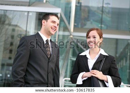 An attractive business team outside their company