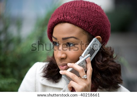 An attractive business woman talking on her cell phone in the city. - stock photo